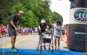 89-Year-Old Speeds to Finish Line, Walker and All